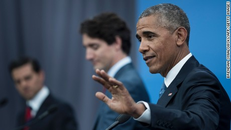 (L-R) Mexican President Enrique Pena Nieto, and Canadian Prime Minister Justin Trudeau look on as  US President Barack Obama speaks during a trilateral press conference at the North American Leaders Summit at the National Gallery of Canada June 29, 2016 in Ottawa, Ontario.