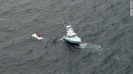 Coast Guard rescues four people after boat capsizes