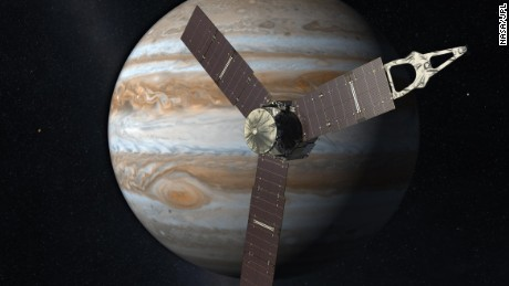 This artist's rendering shows NASA's Juno spacecraft making a close pass over Jupiter.