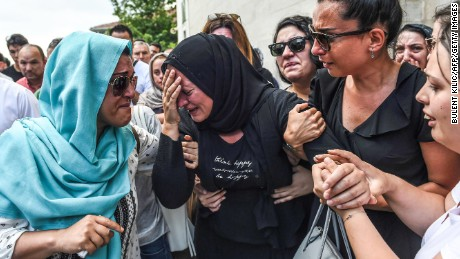 The daughter (center) of Siddik Turgan, a man who was killed in the June 28 attack on Istanbul Ataturk Airport, reacts during his funeral ceremony on June 29 in Istanbul. Turkey declared June 29 a day of national mourning over the deadly attacks.