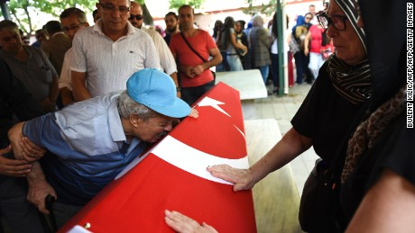 The grandfather of air hostess Gulsen Bahadir, killed during terror attacks on Istanbul Ataturk Airport on June 28, kisses his granddaughter's coffin during her funeral in Istanbul, on June 29.