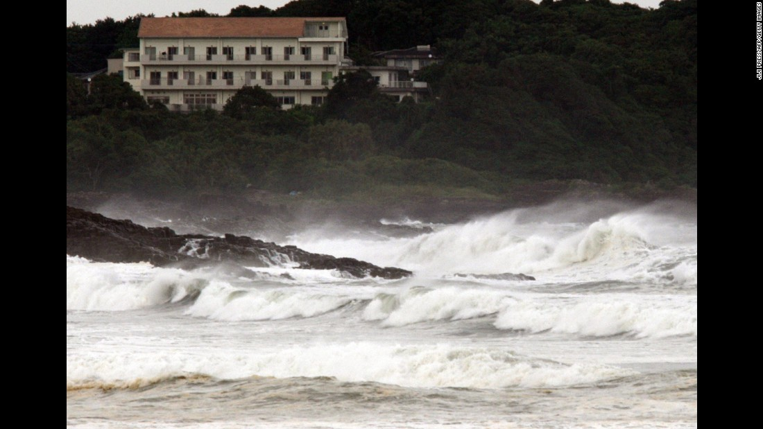 High waves crash into the coast at Hyuga in Miyazaki prefecture, Japan's southern island of Kyushu on July 16, 2015.