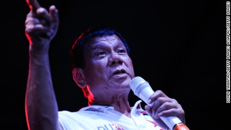 MANILA, PHILIPPINES - MAY 01:  Philippine presidential candidate Rodrigo Duterte gestures during a labor day campaign rally on May 1, 2016 in Manila, Philippines. Duterte, a tough-talking mayor of Davao in Mindanao has been the surprise pre-election poll favourite pulling away from his rivals despite controversial speeches and little national government experience. Opinion polls has shown Mr Duterte has maintained his lead with 33 percent support in the Philippines as Senator Grace Poe looks at impossible odds, with only 22 percent supporting her. The Philippine presidential campaign ends on May 7 with elections slated for May 9 and features 5 presidential candidates vying for the top post.  (Photo by Dondi Tawatao/Getty Images)