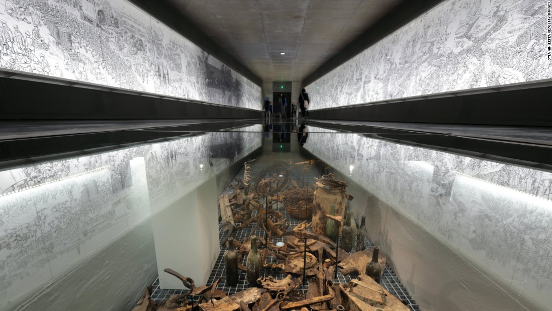 """On exhibition at the new extension of the Thiepval Memorial Visitor Center is an installation of battle artifacts and a 60-meter-long illustrated panorama by Joe Sacco titled, """"The Great War, the first day of the Battle of the Somme."""""""