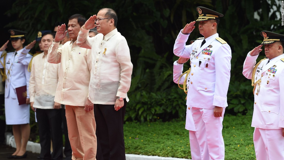 """Newly inaugurated <a href=""""http://www.cnn.com/2016/06/29/asia/philippines-duterte-inauguration/index.html"""" target=""""_blank"""">Philippines president Rodrigo Duterte</a> (center left) stands next to outgoing leader Benigno Aquino (center right), during the departure ceremony for Aquino on June 30, 2016."""