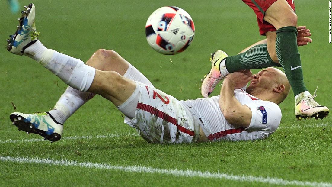 Polish defender Michal Pazdan falls during the match.