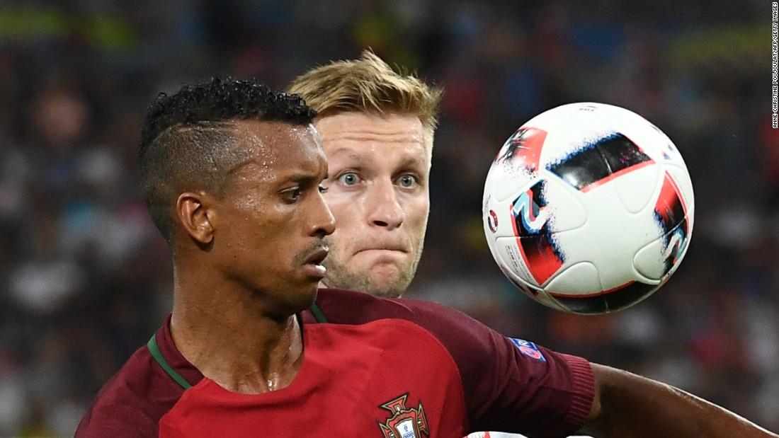 Blaszczykowski, right, eyes the ball near Portugal's Nani.