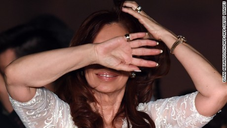 TOPSHOT - (FILES) Argentine President Cristina Kirchner gestures after delivering a speech during a farewell rally on her last day in power at Government Palace in Buenos Aires on December 9, 2015.  A federal prosecutor on April 9, 2016 opened an investigation on former President Cristina Kirchner for presumed money laundering / AFP / EITAN ABRAMOVICH        (Photo credit should read EITAN ABRAMOVICH/AFP/Getty Images)