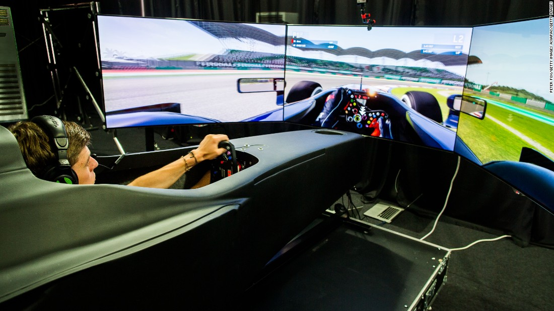 Red Bull driver Max Verstappen tries his hand in the F1 game zone simulator at the 2015 Malaysian Grand Prix.