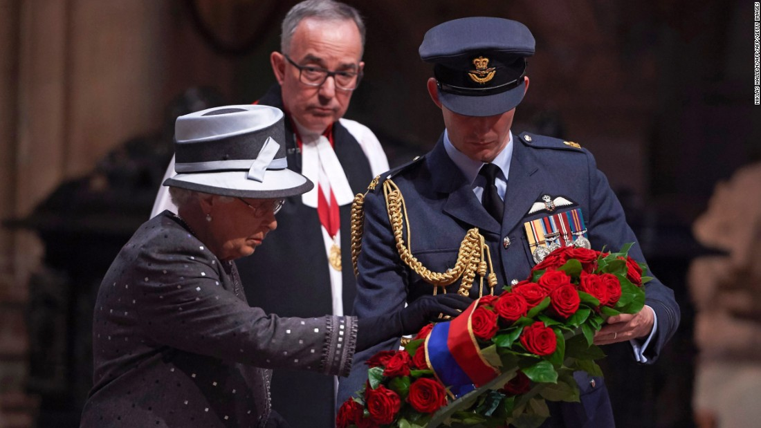 Britain's Queen Elizabeth II lays a wreath of roses and bay leaves on the Grave of the Unknown Warrior during the commemoration service on the eve of the centenary of the Battle of the Somme at Westminster Abbey in London, on the evening of June 30. The overnight vigil is the first to be held in the Abbey since peace vigils for the Cuban Missile Crisis over 50 years ago. The vigil is part of a program of centenary events being held in Scotland, Wales and Northern Ireland, and at Thiepval in northern France.