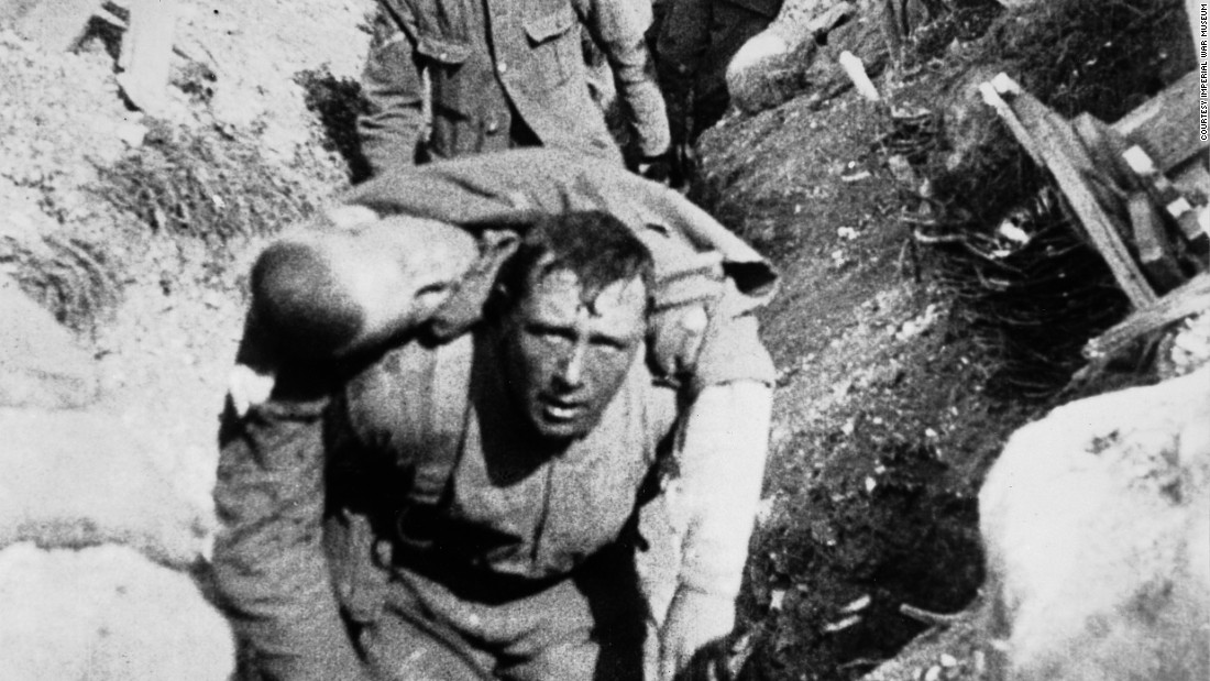 """A still from the film, """"The Battle of the Somme,"""" shows a British soldier carrying a wounded comrade back from the front line. The scene is generally accepted as having been filmed on the first day of the battle on July 1, 1916. The film and film stills are part of the Imperial War Museum's collections, and the film is featured in IWM London's new exhibition, """"Real to Reel: A Century of War Movies."""""""