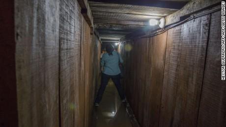 A journalist walks along a tunnel through which Guzman tried to escape.