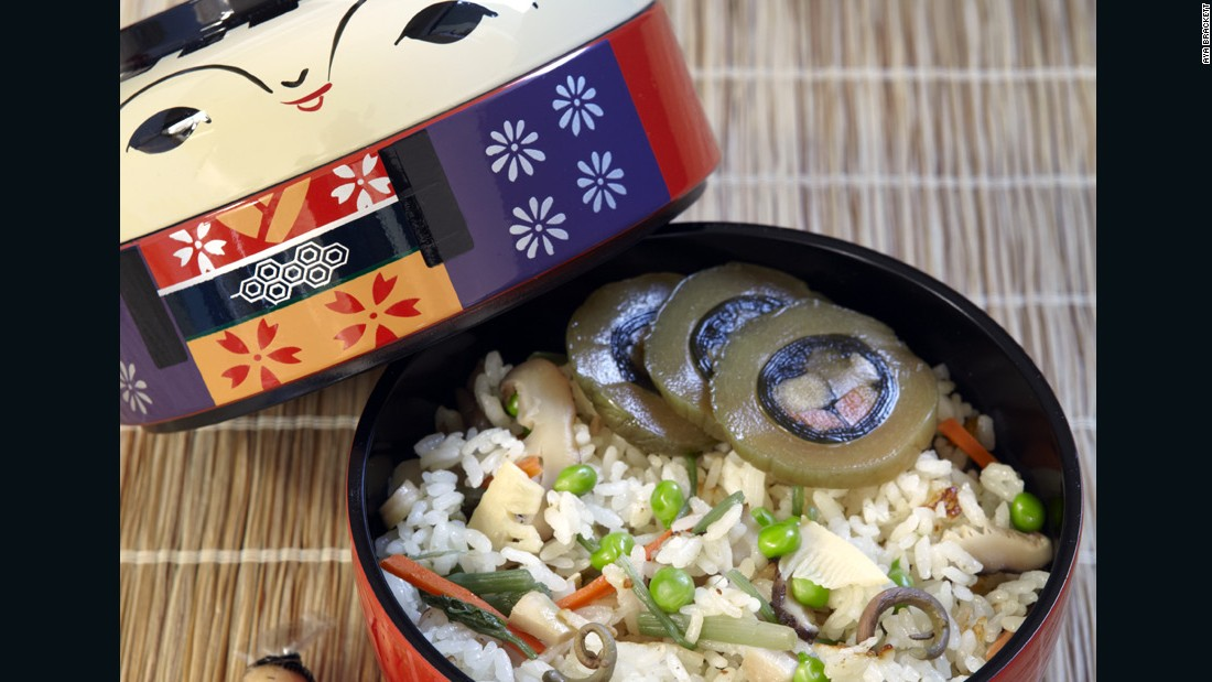 This fried tofu and mountain vegetable pilaf is served in a special kokeshi-shaped bento box. Kokeshi dolls are one of the most popular souvenirs in Tohoku.