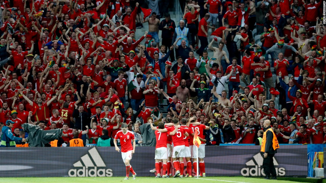 Welsh players celebrate Sam Vokes' late second-half header that gave them a 3-1 victory over Belgium on Friday, July 1. Wales will play in the semifinals against Portugal next week.