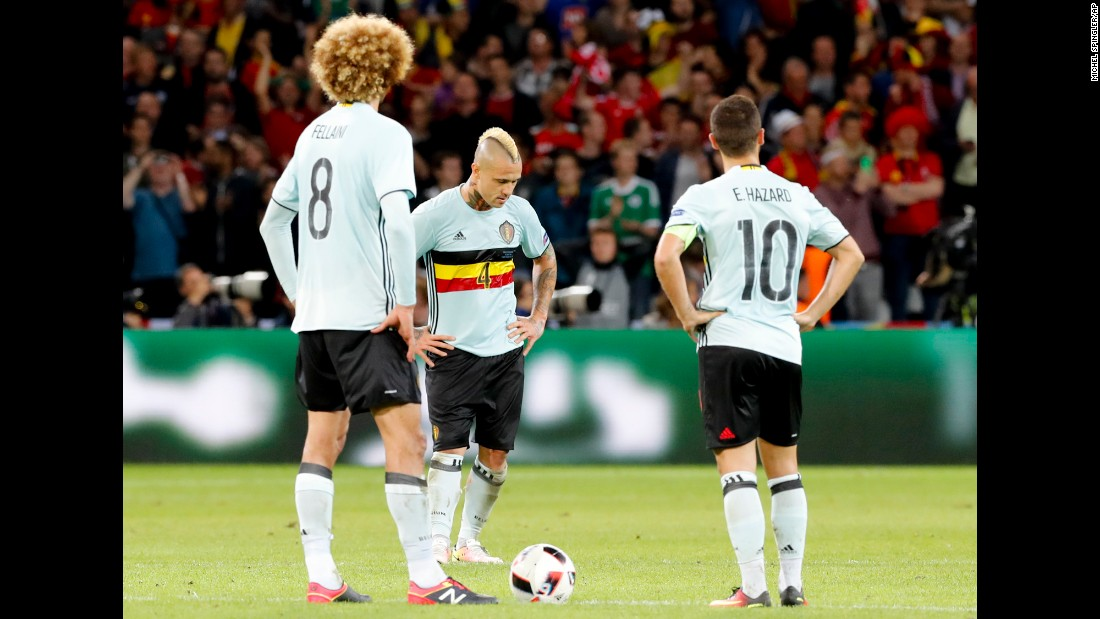 From left, Belgian players Marouane Fellaini, Radja Nainggolan and Eden Hazard react to Vokes' goal in the 85th minute.