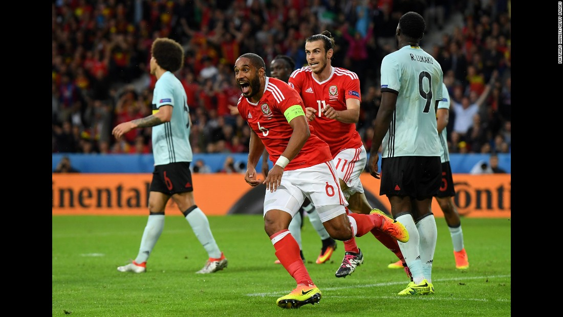 Welsh defender Ashley Williams is trailed by Bale after scoring a header in the first half. Williams' goal tied the match at 1-1.