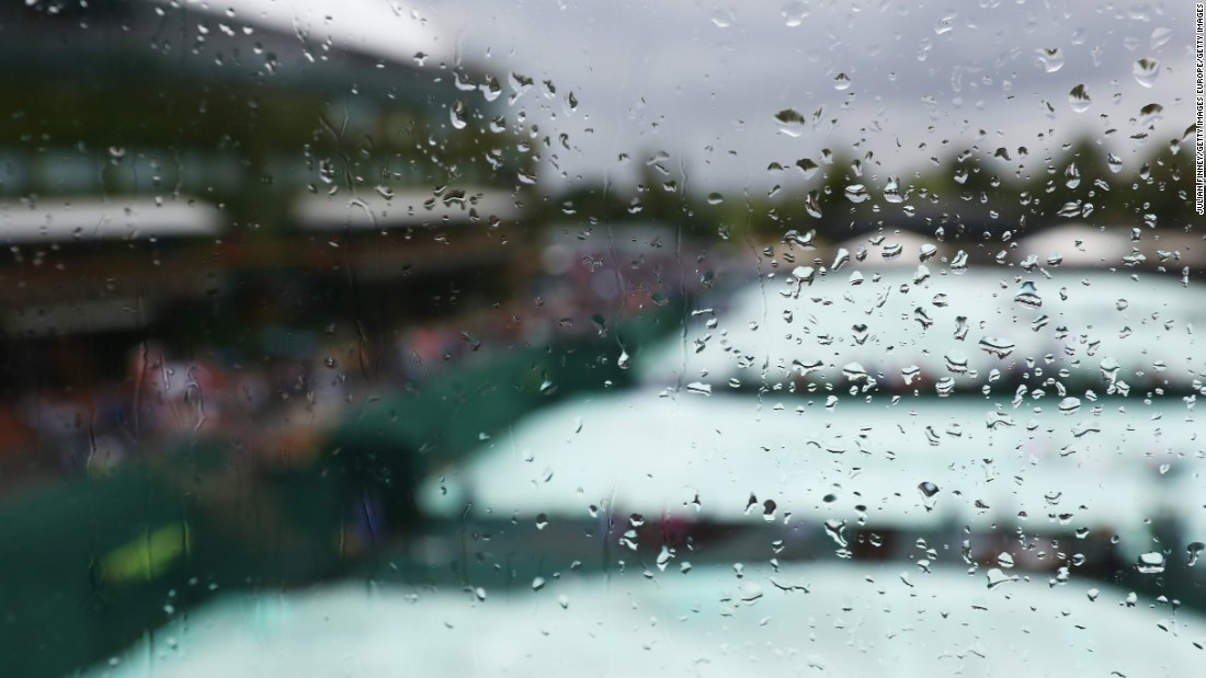 Del Potro and Wawrinka played under a roof on Centre Court ... because of yet more rain at SW19.