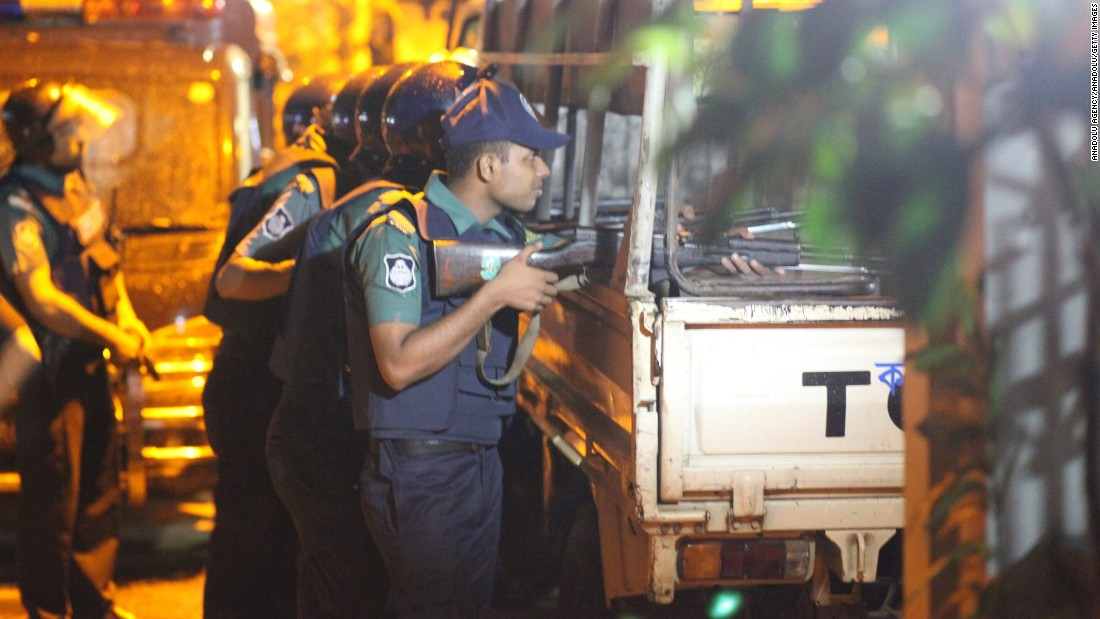 Bangladeshi police stand guard outside the Holey Artisan Bakery cafe, where the attack took place. The cafe is in Gulshan, one one of Dhaka's most affluent neighborhoods and a diplomatic enclave.