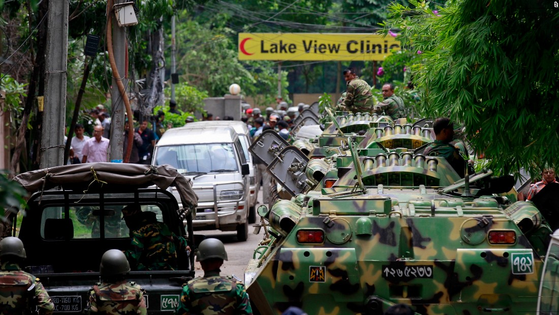 Bangladesh security personnel patrol the streets of Dhaka on Saturday, July 2 after gunmen seized a bakery in the capital overnight, killing 20 hostages and two officers, according to the military.