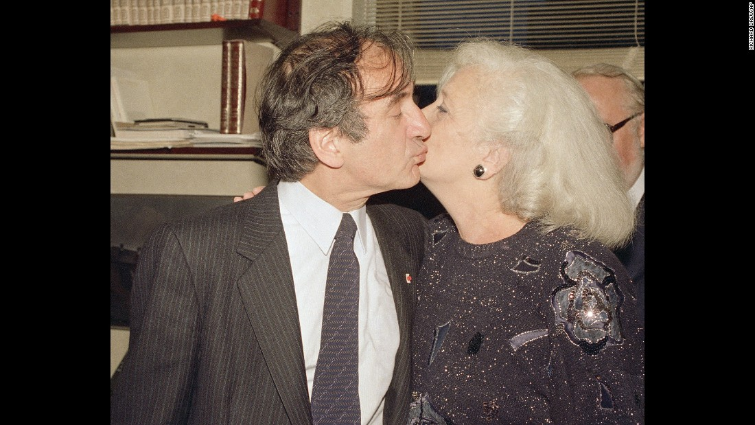 Author and Nazi death camp survivor Elie Wiesel kisses his wife, Marion, as they greet the press in their apartment in New York on October 14, 1986, after it was announced that Wiesel was awarded the Nobel Peace Prize. Wiesel, who wrote extensively about his experiences during the Holocaust, died July 2, 2016, at age 87.