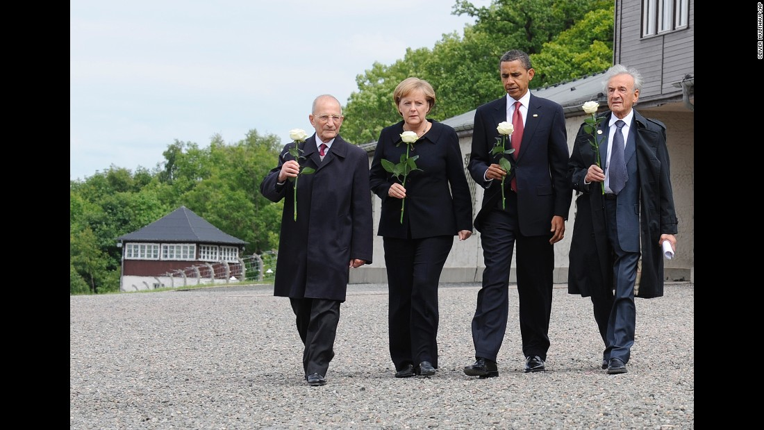 Buchenwald survivors Elie Wiesel, right, and Bertrand Hertz, left, walk with German Chancellor Angela Merkel and U.S. President Barack Obama at the Buchenwald camp near Weimar, Germany, on  June 5, 2009. Wiesel, 87, died on July 2, 2016.