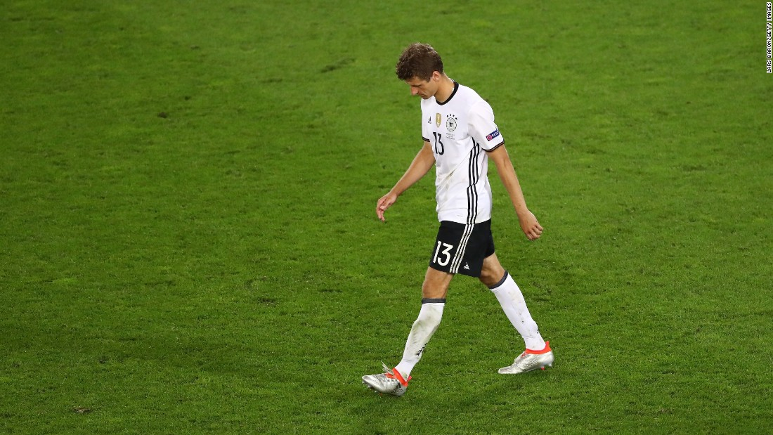Thomas Mueller of Germany walks off after his penalty was saved by Italy's Gianluigi Buffon.