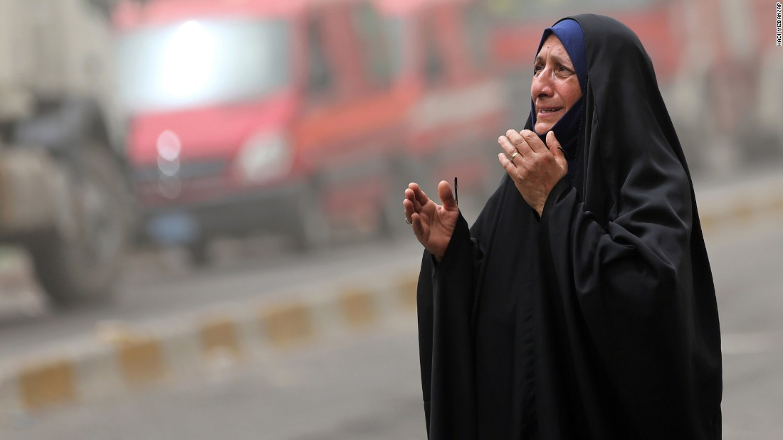 An Iraqi woman grieves at the scene of the Karrada blast on July 3. A second bomb exploded Sunday at an outdoor market in the Shaab neighborhood of southeastern Baghdad, killing one person and wounding five others, police said. Both Baghdad strikes are a sign of the Sunni-Shiite tension in the Muslim world. Sunni-dominated ISIS claimed it was targeting Shiite neighborhoods.