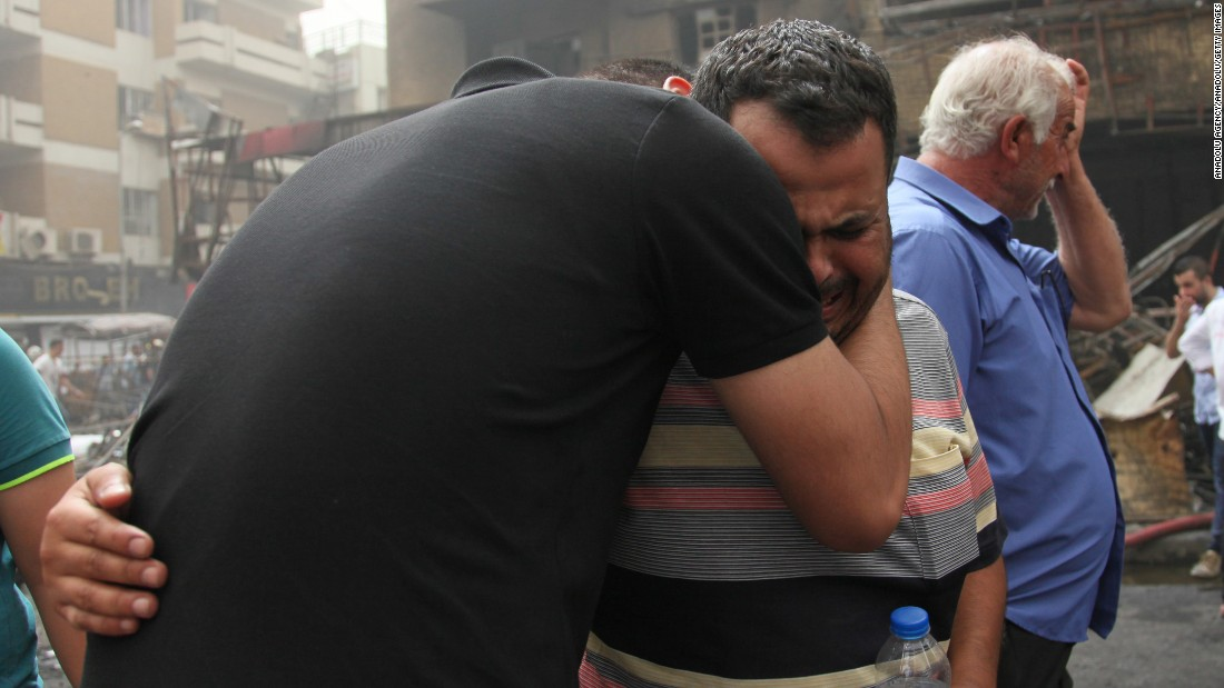 People who lost their relatives mourn after the bombing.