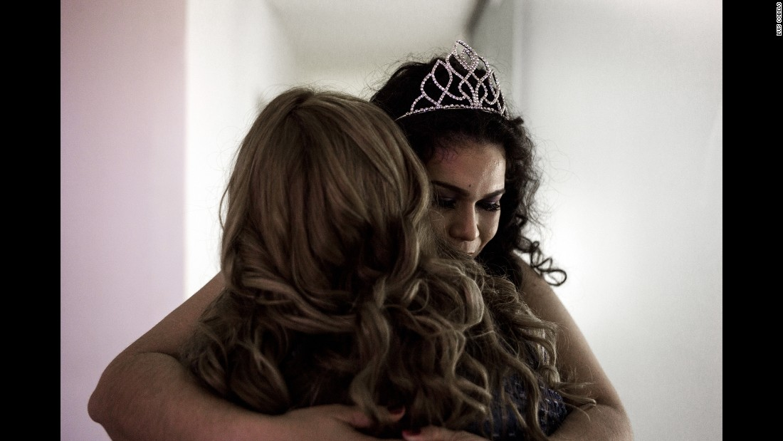 """Raquel Gimenez hugs a contestant before the Miss Gordita beauty pageant begins in Asuncion, Paraguay. Gimenez was the 2015 winner of the pageant, which translates to """"Miss Chubby"""" in English. It was started to fight discrimination and improve the contestants' health."""