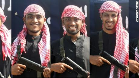 Bangladesh mourns as ISIS claim debated