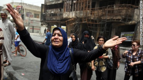 An Iraqi woman reacts on Monday, July 4, at the site of a suicide-bombing attack which took place a day earlier in Baghdad's Karrada neighborhood. Iraqis mourned more than 200 people killed by a jihadist-claimed suicide car bombing that was among the deadliest ever attacks in the country. The blast, which the Islamic State group said it carried out, hit the Karrada district early on July 3 as the area was packed with shoppers ahead of this week's holiday marking the end of the Muslim fasting month of Ramadan.