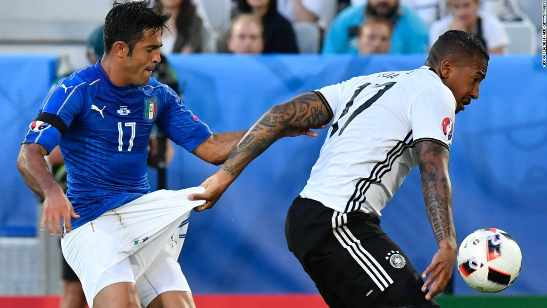 """German defender Jerome Boateng grabs the shorts of Italian forward Eder during a Euro 2016 quarterfinal match on Saturday, July 2. <a href=""""http://www.cnn.com/2016/07/02/football/germany-italy-euro-2016/"""" target=""""_blank"""">Germany advanced</a> after a dramatic penalty shootout."""