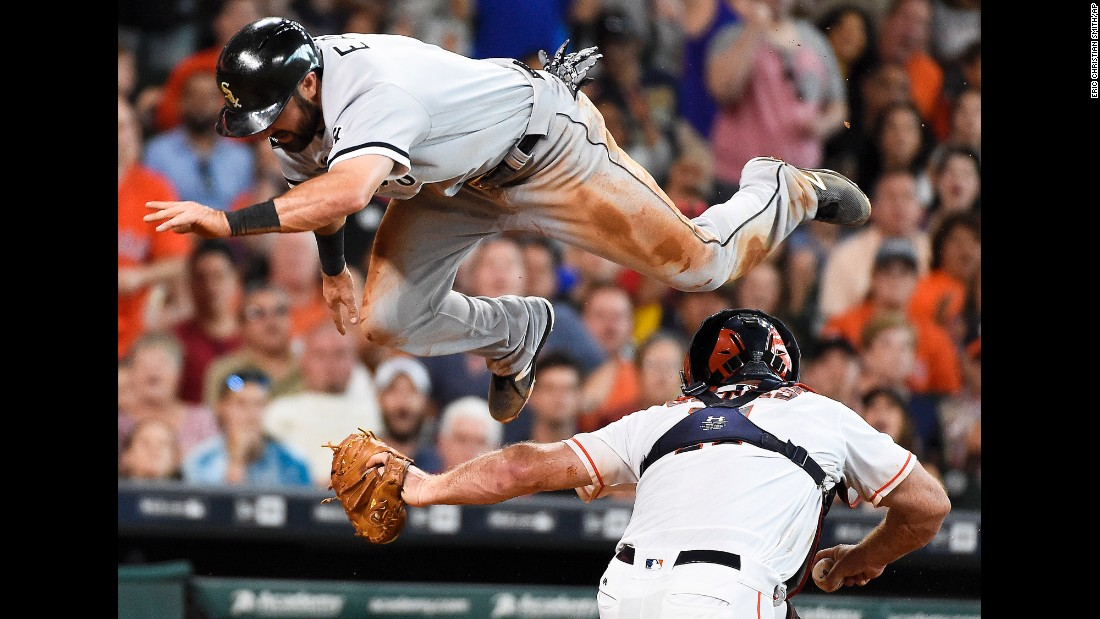 Adam Eaton, outfielder for the Chicago White Sox, leaps over Houston catcher Evan Gattis on Saturday, July 2. He was tagged out on the play.