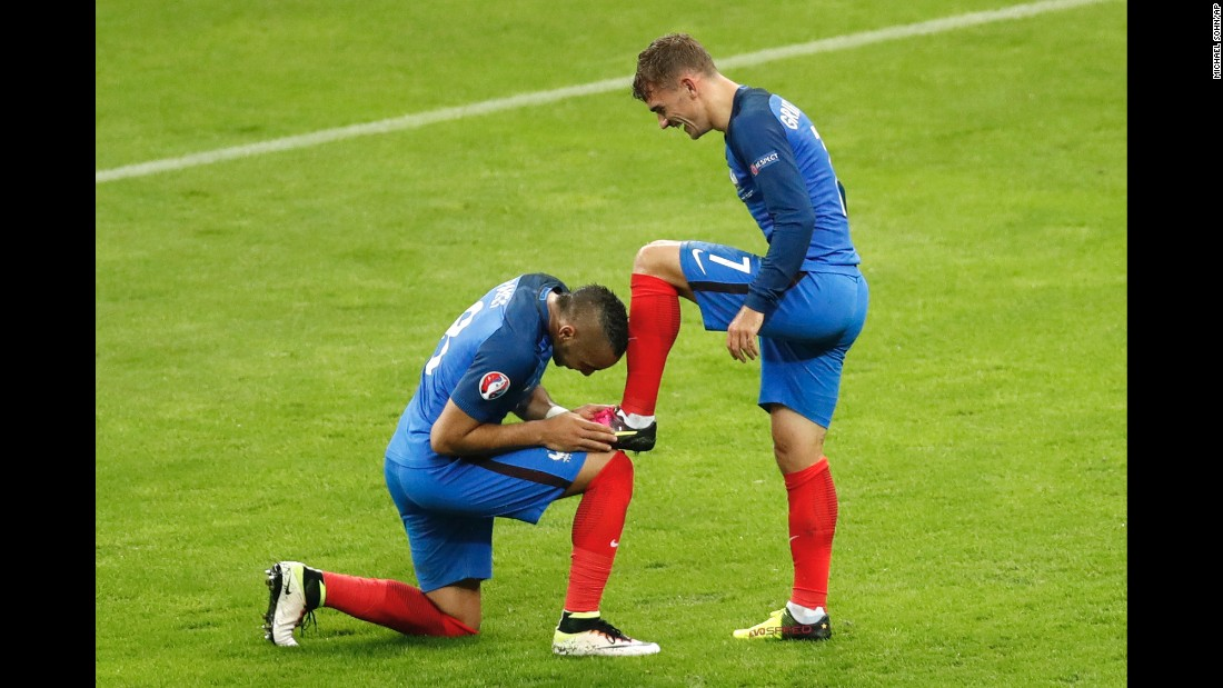 """Dimitri Payet kisses the boot of his French teammate, Antoine Griezmann, after Griezmann scored a goal against Iceland on Sunday, July 3. <a href=""""http://www.cnn.com/2016/07/03/football/france-iceland-euro-2016-quarterfinal/"""" target=""""_blank"""">France won 5-2 </a>to advance to the semifinals of Euro 2016."""