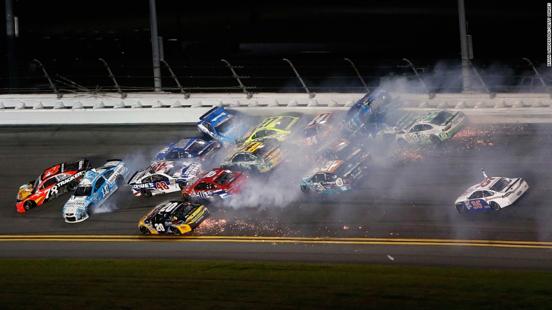Numerous cars are collected in a wreck during the Sprint Cup race at Daytona on Saturday, July 2.