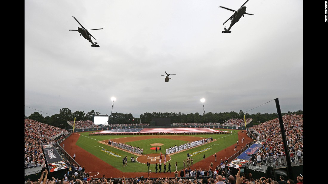 """Military helicopters fly over a field at Fort Bragg, North Carolina, prior to <a href=""""http://www.cnn.com/2016/07/01/sport/marlins-braves-at-fort-bragg/"""" target=""""_blank"""">a special Major League Baseball game </a>between Miami and Atlanta on Sunday, July 3. The vast majority of seats were reserved for U.S. service members and their families. <a href=""""http://www.cnn.com/2016/06/28/sport/gallery/what-a-shot-0628/index.html"""" target=""""_blank"""">See 27 amazing sports photos from last week</a>"""