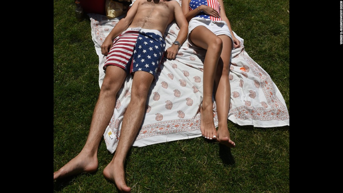 A couple decked out in patriotic garb relaxes in New York's Central Park.