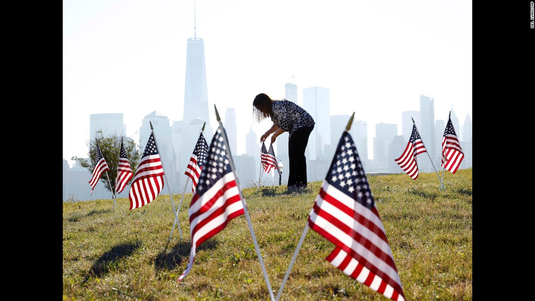 Yalenny Vargas arranges flags at Liberty State Park in Jersey City, New Jersey.