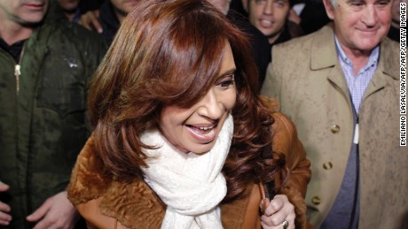 Former Argentine President Cristina Fernandez de Kirchner (front) arrives at the Jorge Newbery airport in Buenos Aires on July 2, 2016.  / AFP        (Photo credit should read /AFP/Getty Images)