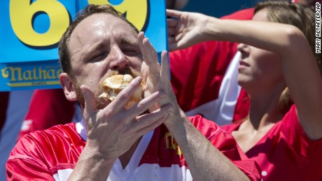 Joey Chestnut heads to victory in Nathan's Famous Fourth of July International Hot Dog Eating Contest on  Monday, July 4, 2016, in New York. Chestnut's winning tally was 70 hot dogs and buns in 10 minutes.