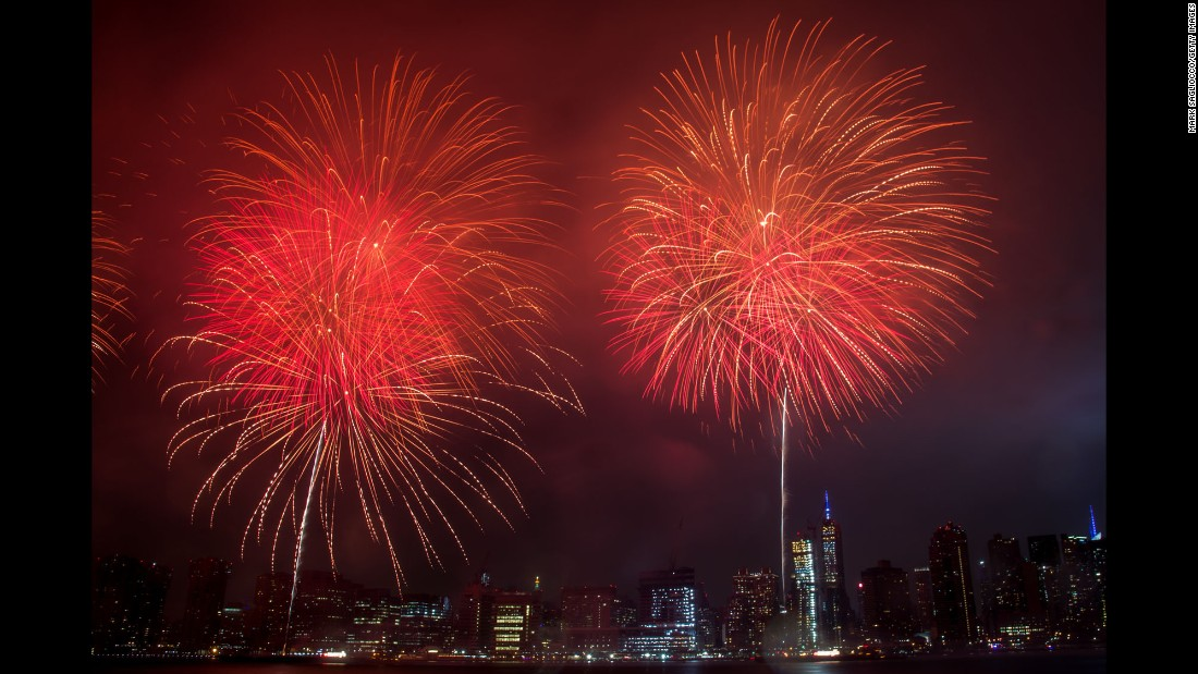 Fireworks explode over the East River in New York on Monday, July 4.