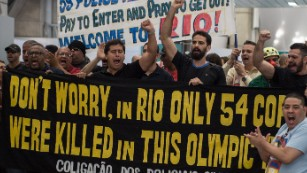 Police and firefighters protest over pay Monday at the Rio de Janeiro airport.