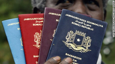 Nairobi, KENYA:  Somali Immigration and Naturalization Director Abdullahi Gafow Mohamud shows copies of the country's new passport, 08 November 2006. The new state-of-the-art passport, to be re-issued in a massive drive within Somalia and the rest of the world, will replace an older document that has been easier to forge, which was introduced under dictator Mohammed Siad Barre's regime. AFP PHOTO/TONY KARUMBA  (Photo credit should read TONY KARUMBA/AFP/Getty Images)