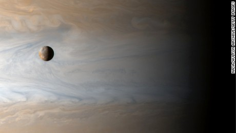 388097 01: Gliding past the planet Jupiter, the Cassini spacecraft captures this awe inspiring view of active Io, Jupiter's third largest satellite, with the largest gas giant as a backdrop, offering a stunning demonstration of the ruling planet's relative size, April 20, 2001. The Cassini spacecraft itself was about 10 million kilometers from Jupiter when recording the image data. (Photo courtesy of NASA/Newsmakers)