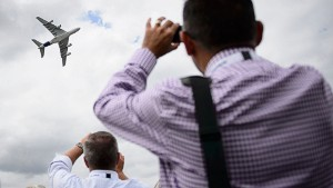People take pictures as an Airbus A380 aircraft performs a flight display at the Farnborough Air Show in Hampshire, southern England, on July 16, 2014. European aircraft maker Airbus won orders for its passenger planes from leasing companies worth about $25 billion at the Farnborough airshow on Tuesday, far outpacing its US rival Boeing.  AFP PHOTO / LEON NEAL        (Photo credit should read LEON NEAL/AFP/Getty Images)
