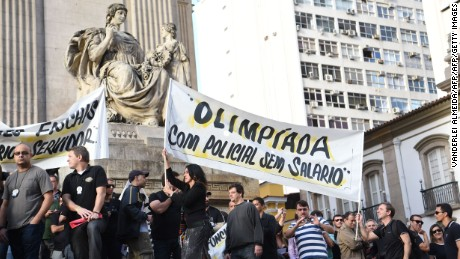 """Civil police officers threatening to go on strike demonstrate against the government for arrears in their salary payments, in Rio de Janeiro, Brazil, June 27, 2016, t Earlier this month, Rio state authorities declared a """"state of public calamity"""" over a major budget crisis in order to release emergency funds to finance the Olympic Games due to begin in August. / AFP / VANDERLEI ALMEIDA        (Photo credit should read VANDERLEI ALMEIDA/AFP/Getty Images)"""
