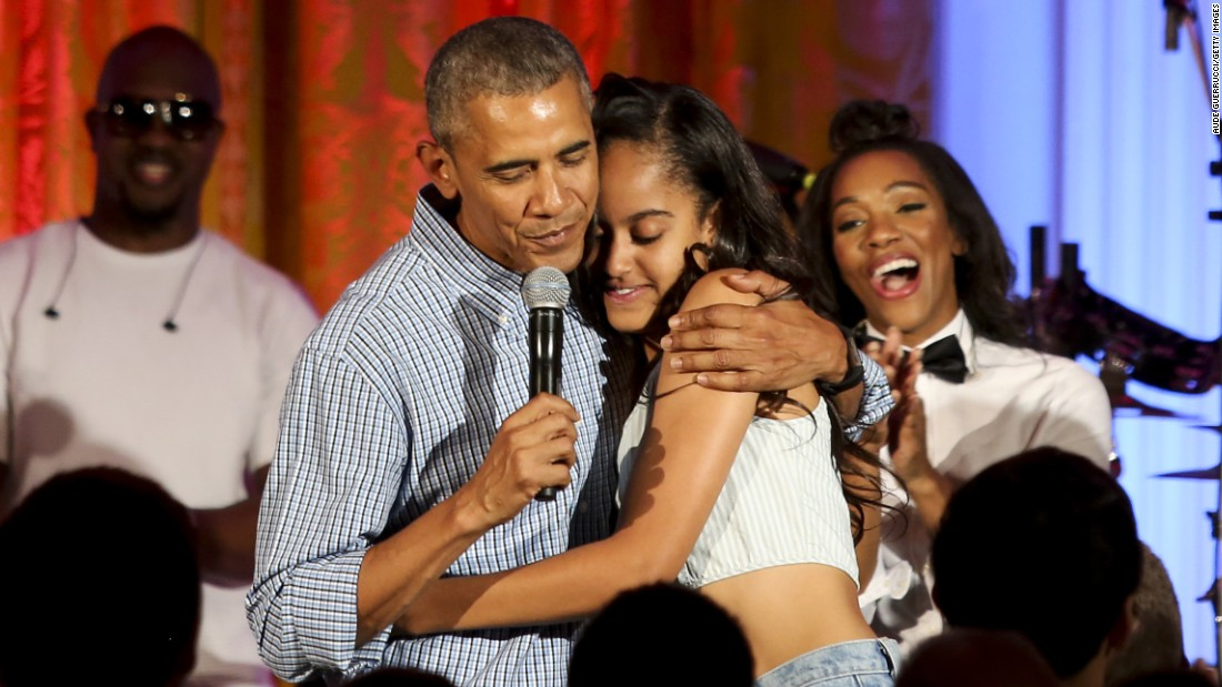 U.S. President Barack Obama hugs his daughter Malia at the White House Fourth of July party in 2016. She was celebrating her 18th birthday during the party, which including musicians Janelle Monae and Kendrick Lamar. Click through the gallery to see pictures of Malia and Sasha Obama since their father was elected President in 2008.
