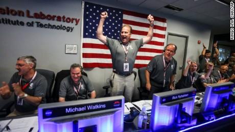 The Juno team celebrates at Mission Control at NASA's Jet Propulsion Laboratory in Pasadena, California.