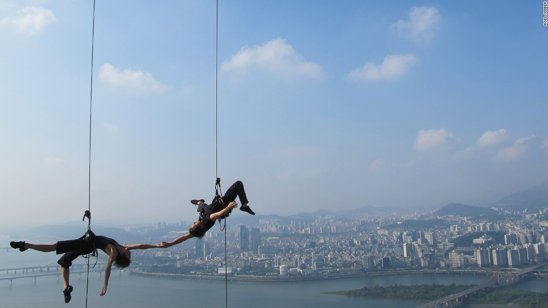 BANDALOOP is an American company founded in 1991. They've performed in locations around the world -- from a water tower in South Africa to mountains in the Himalayas.