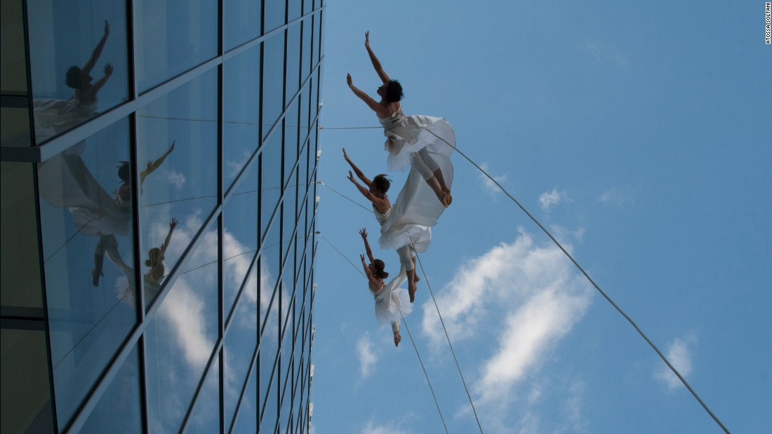 The troupe has danced suspended from buildings measuring over 400 feet tall and on mountaintops 2,700 feet above the ground.  <br />